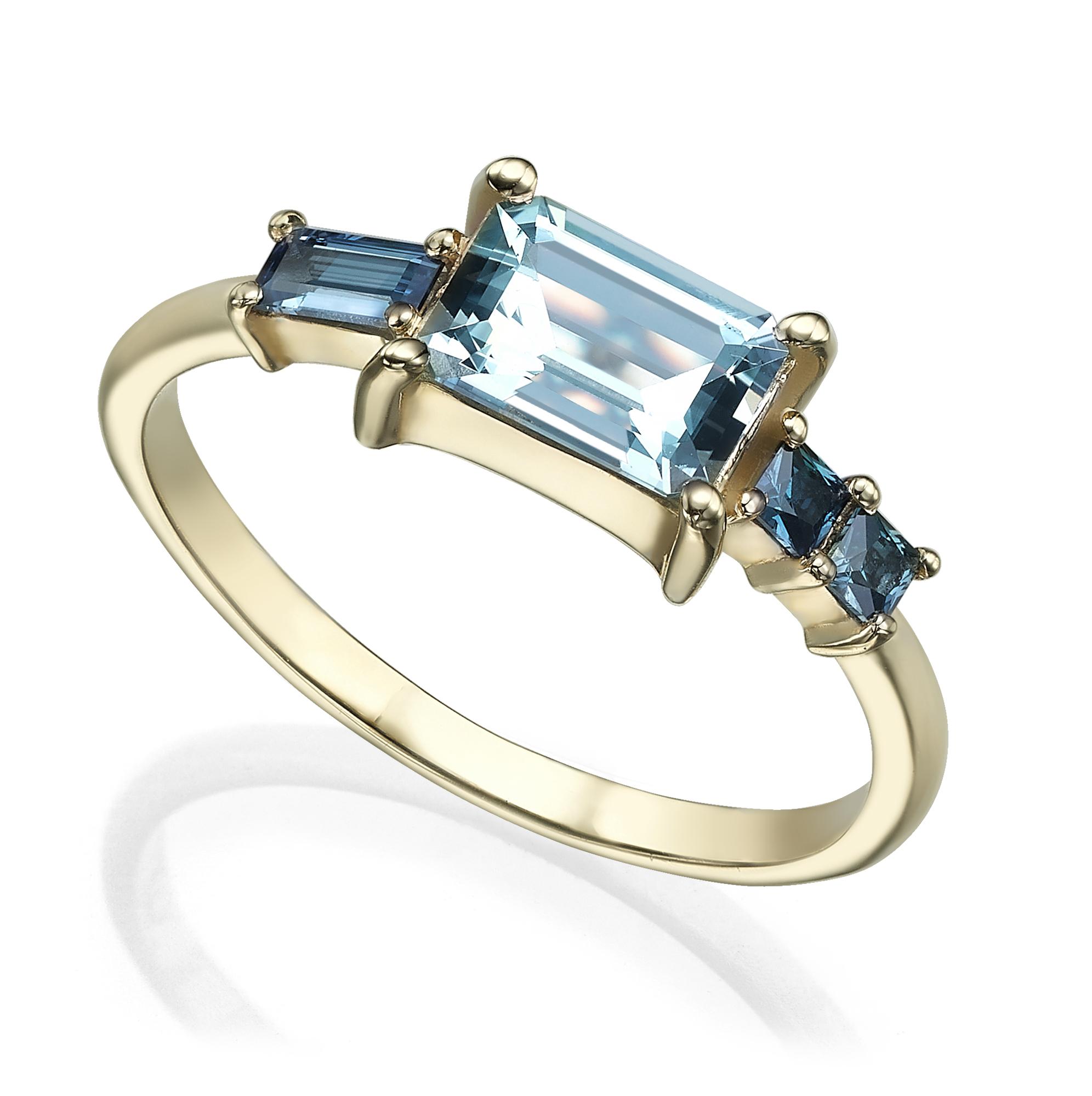 טבעת זהב משובצת אקוואה מרין בחיתוך אמרלד קאט וספירים בחיתוך פרינסס ובגט בצדדים